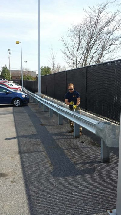 man fixing guard rail