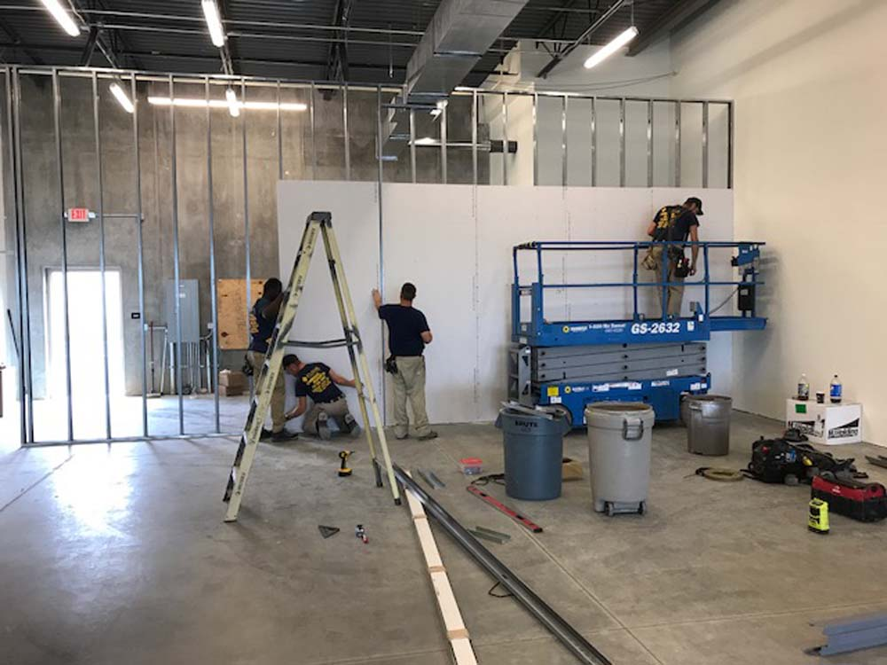 Men hanging drywall