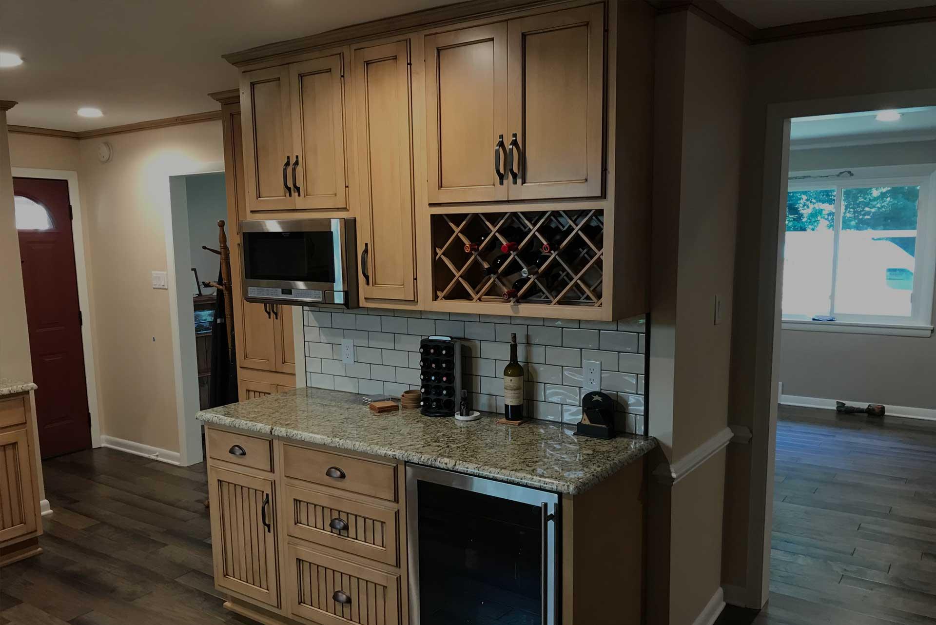 kitchen with hardwood floor & brown cabinets