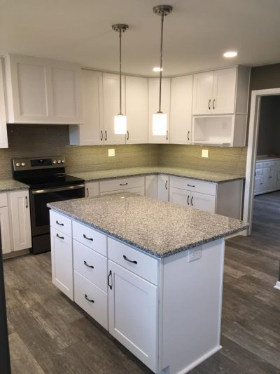 White kitchen with granite countertop